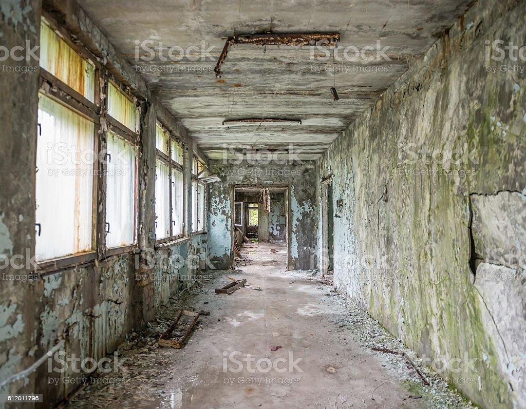 abandoned ruined corridor in Pripyat school stock photo