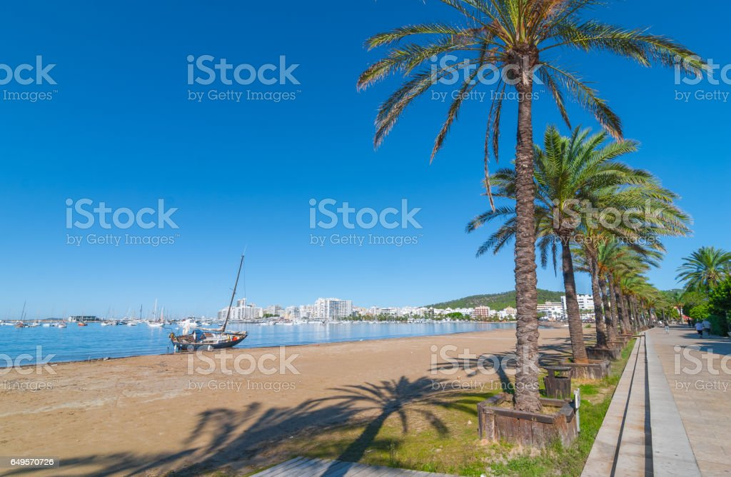 Abandoned sail boat left alone on the beach. stock photo