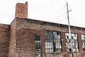 Abandoned School Power Plant with Crumbling Brick Smokestack III