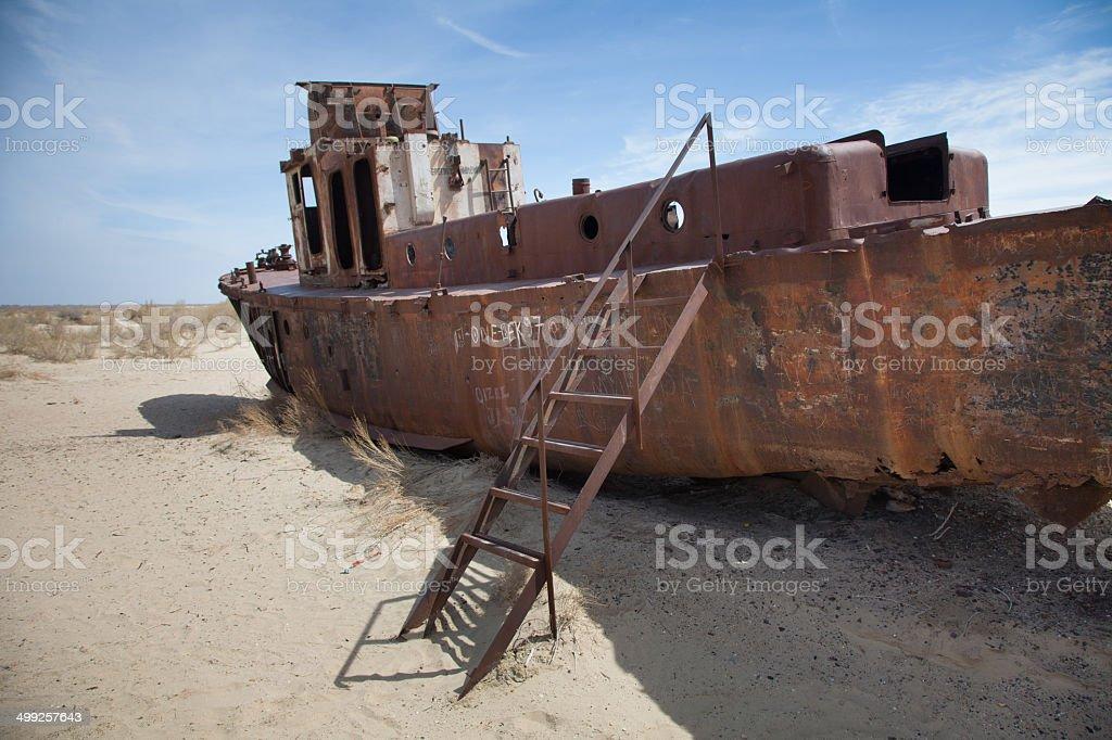 Abandoned ship in Aral Desert, Moynaq, Karakalpakstan, Uzbekistan royalty-free stock photo