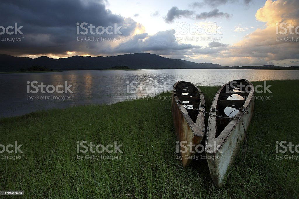 Abandoned ship in lake at sunrise royalty-free stock photo