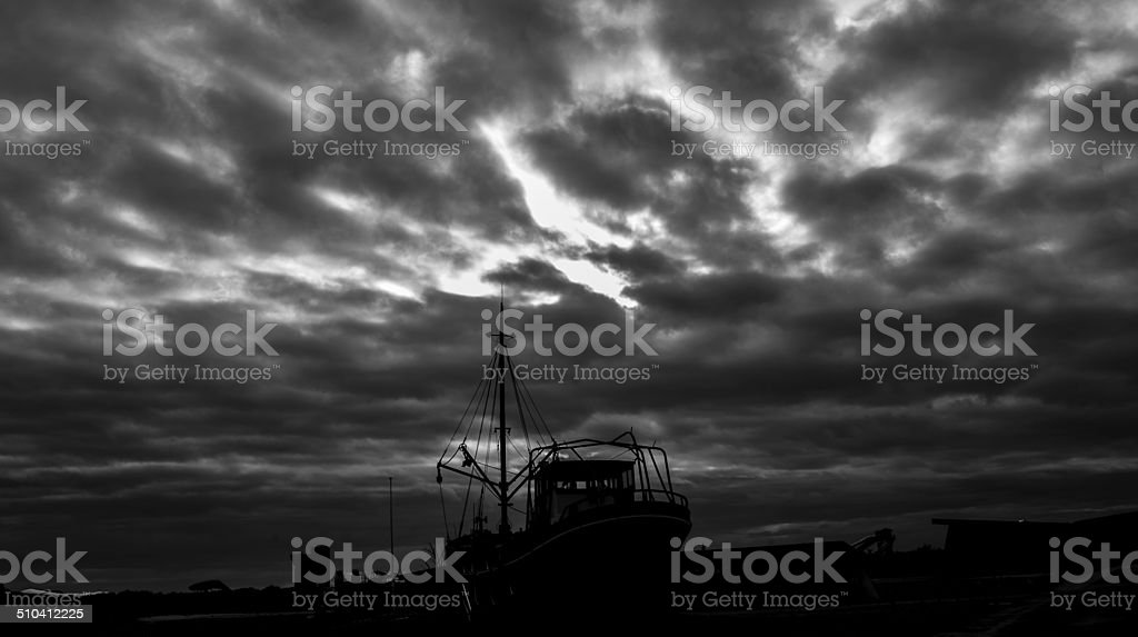 Abandoned ship with cloud stock photo