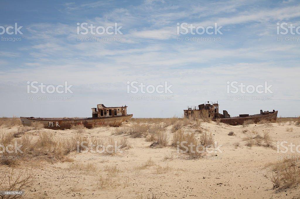 Abandoned ships in Aral Desert, Moynaq, Karakalpakstan, Uzbekistan royalty-free stock photo