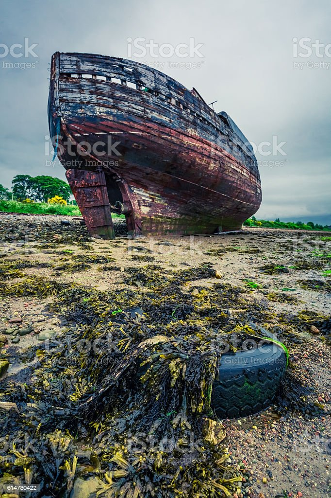 Abandoned shipwreck on shore in Fort William, Scotland stock photo