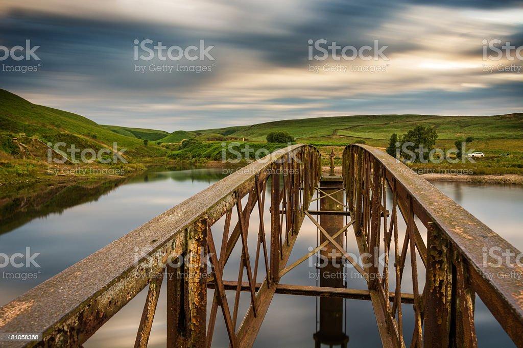 Abandoned Steel Bridge Over Lake On Clody Day. stock photo