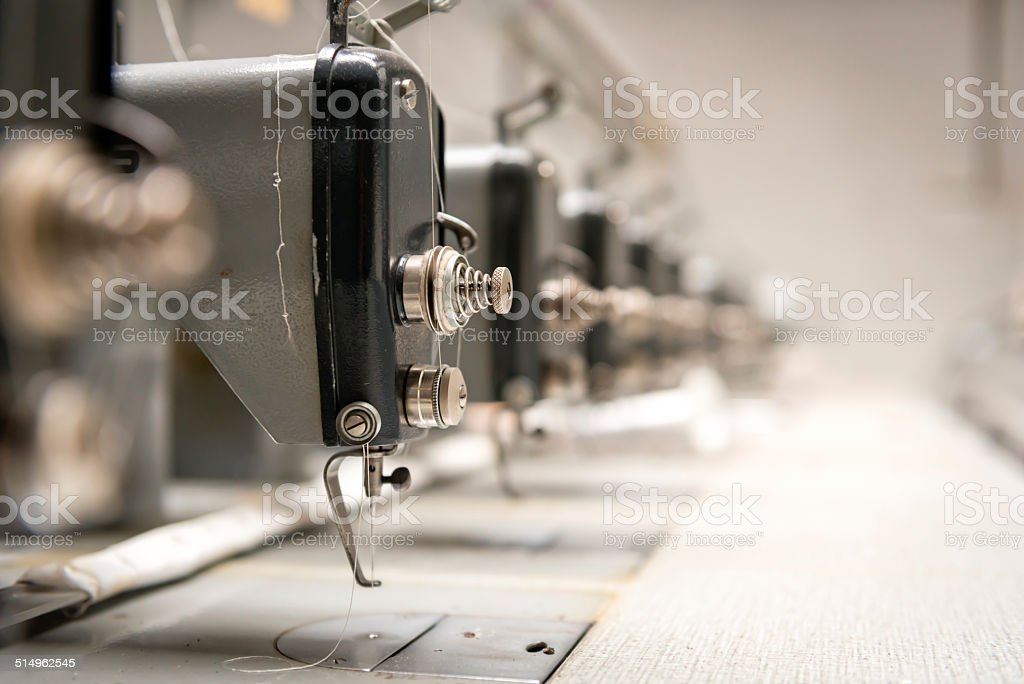Abandoned textile factory - sewing machines stock photo