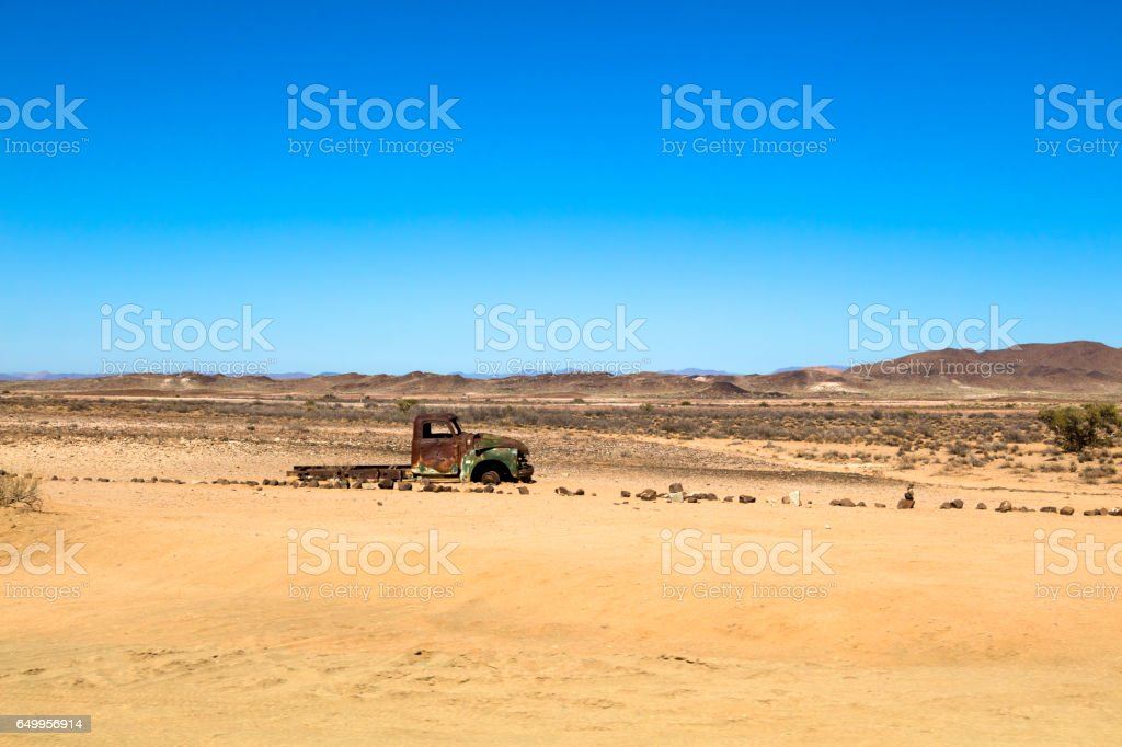 Abandoned truck in the desert stock photo
