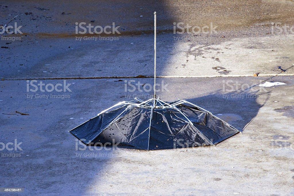 Abandoned umbrella stock photo