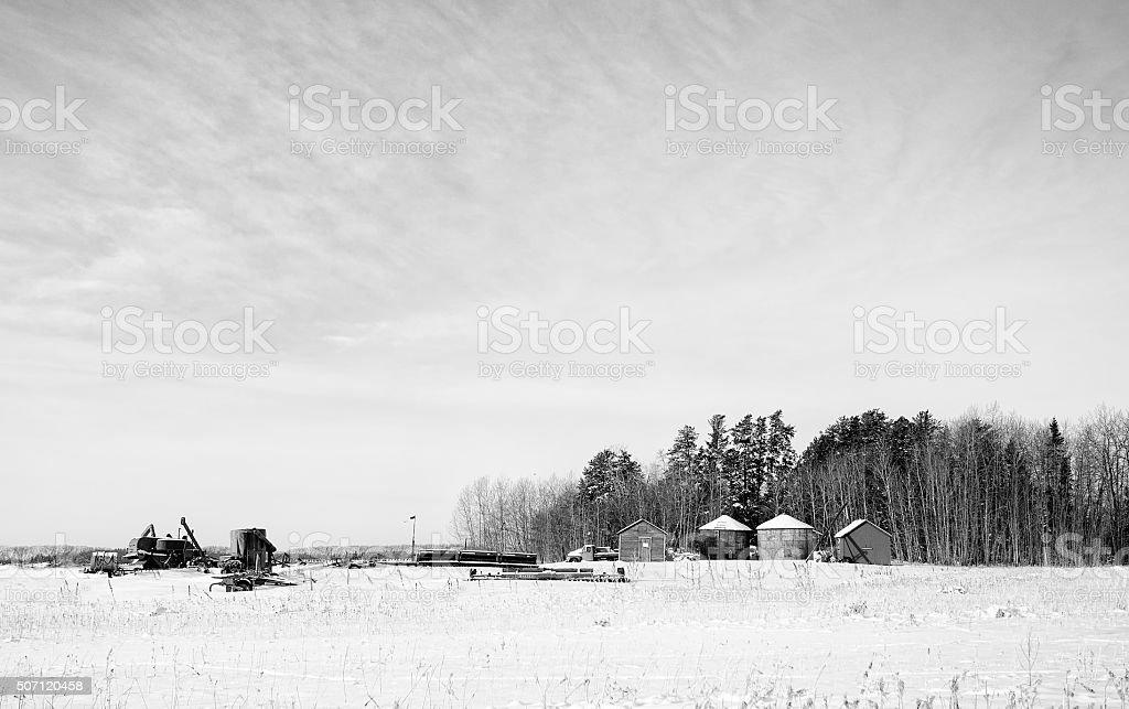 Abandoned vintage farm equipment in winter landscape stock photo