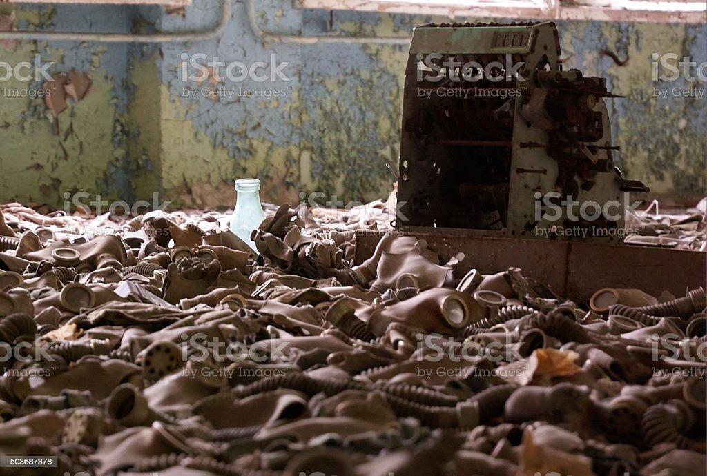abandoned warehouse full of soviet old fashion gaz masks stock photo