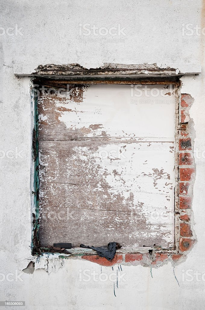 Abandoned Window Covered with Wood Panels royalty-free stock photo