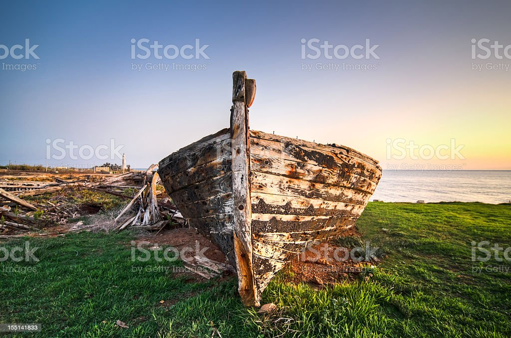 abandoned wooden boat at sunset royalty-free stock photo