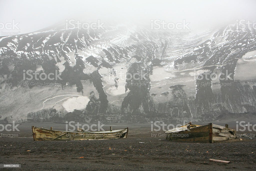 Abandoned wooden boats at Whalers' Bay, Deception Island, Antarctica stock photo