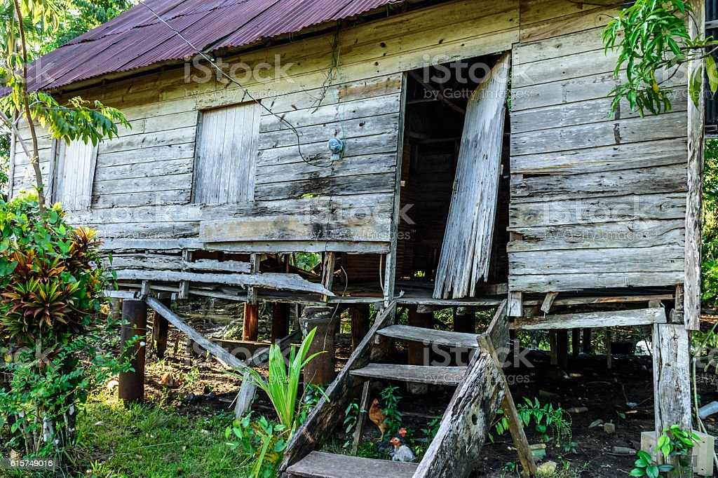 Abandoned wooden house in Caribbean town stock photo