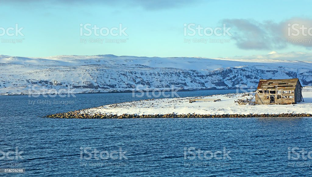 Abandoned wooden house on northern coast of Norway stock photo