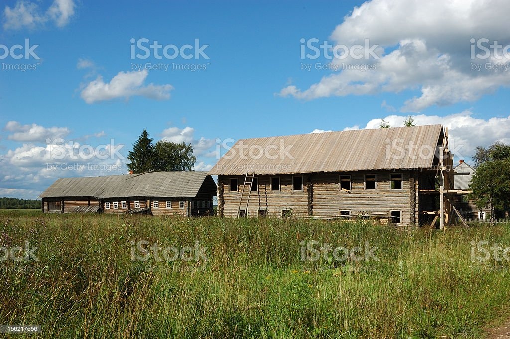 Abandoned wooden houses in russian village royalty-free stock photo