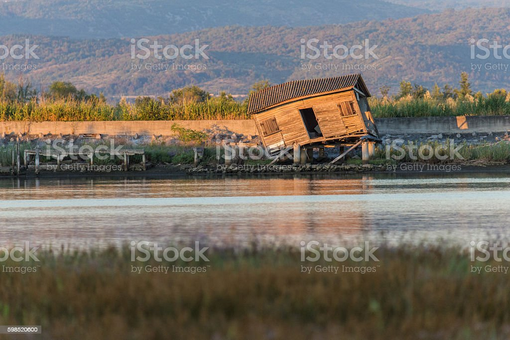 Abandoned wooden shack by the sea stock photo