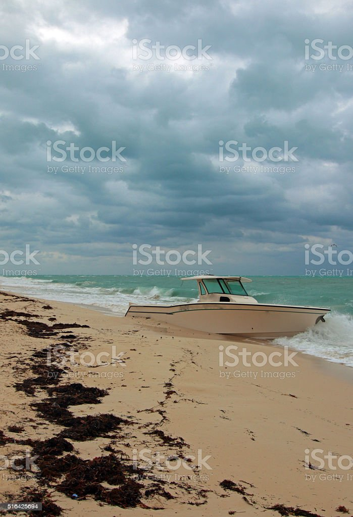 Abandoned Wrecked Beached Boat in Isla Blanca Cancun Mexico stock photo