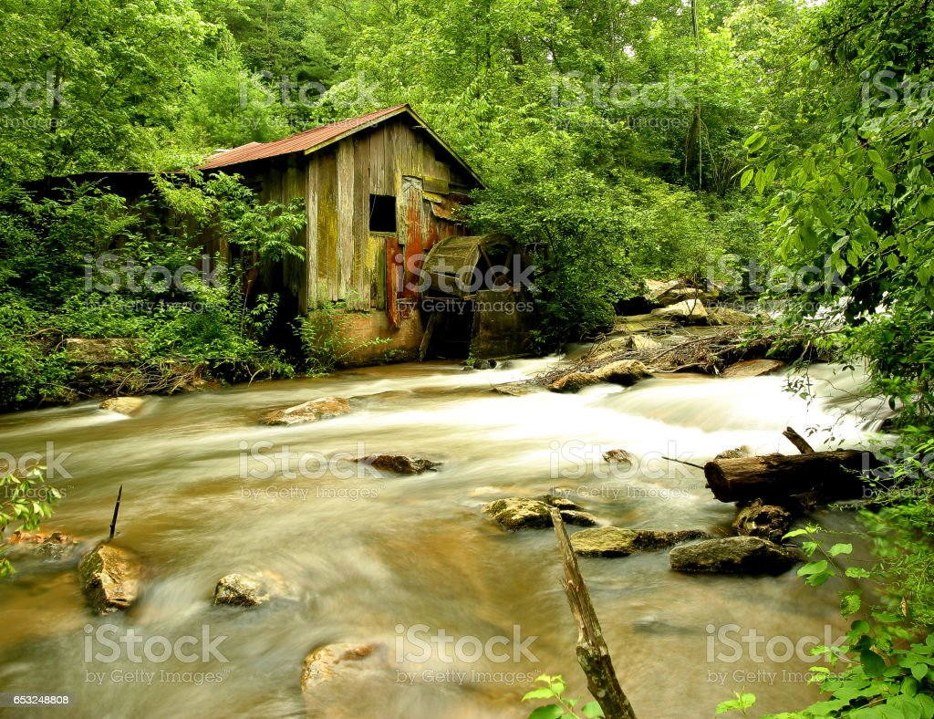 Abandoneded water mill stock photo