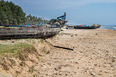 Abandonned artistic wooden canoe on a lonely beach