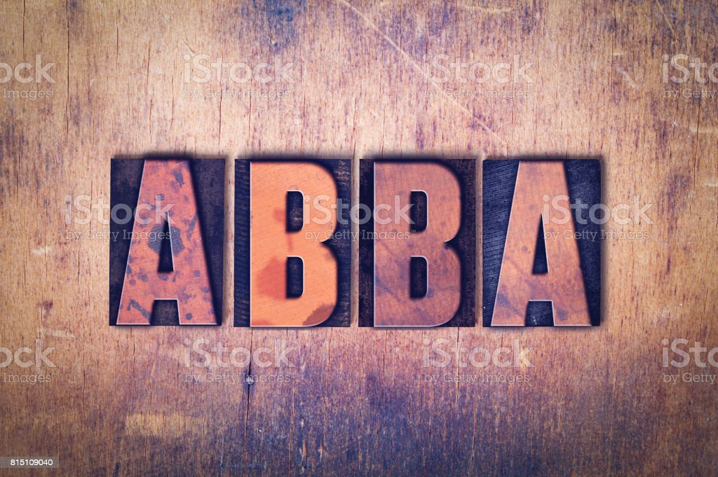 Abba Theme Letterpress Word on Wood Background stock photo