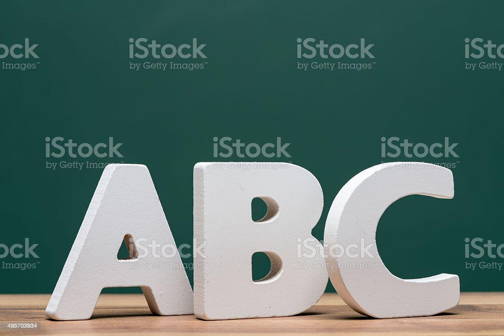 abc letters in front of board stock photo