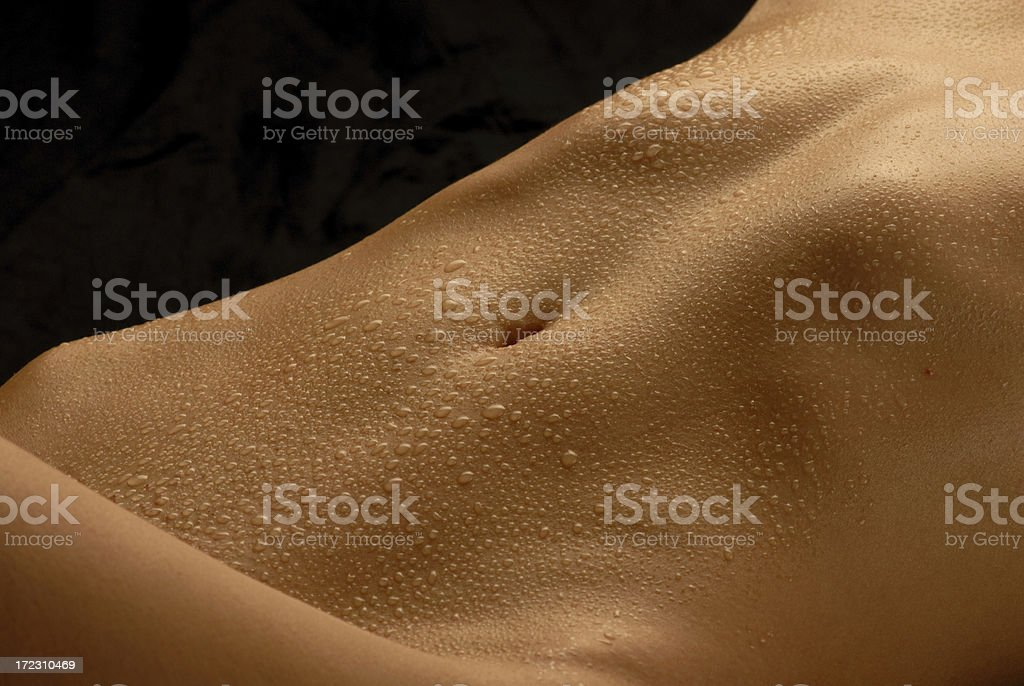 abdomen with water-drops royalty-free stock photo