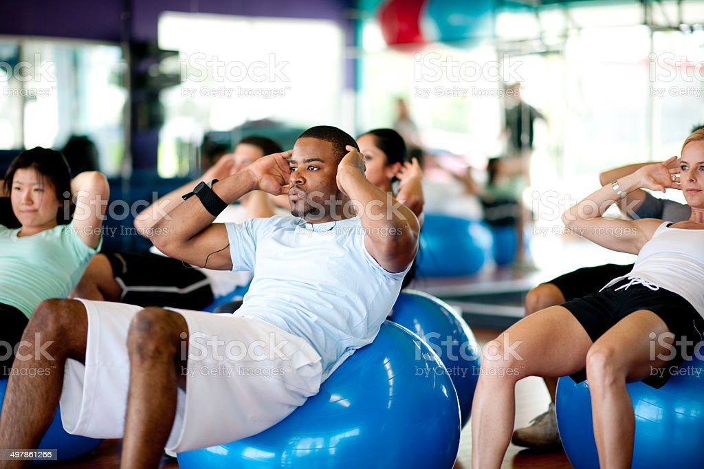Abdominal Workout at the Gym stock photo