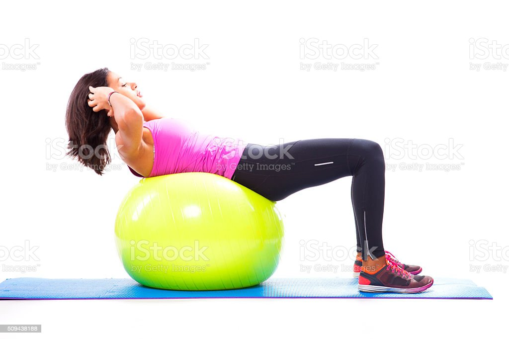 Abdominals with a fitness ball stock photo