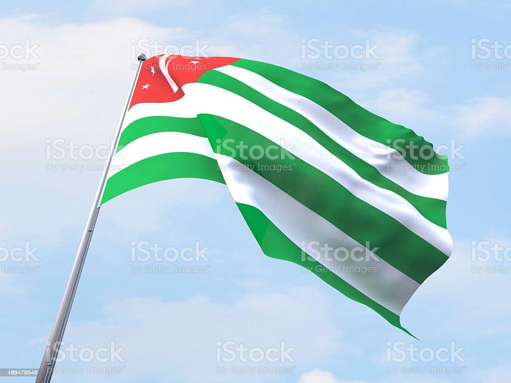 Abkhazia flag flying on clear sky. stock photo