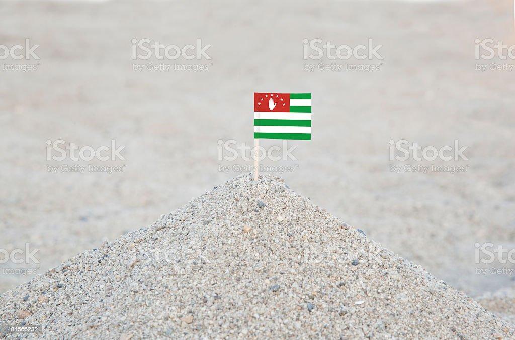 Abkhazia Flag on the Beach stock photo