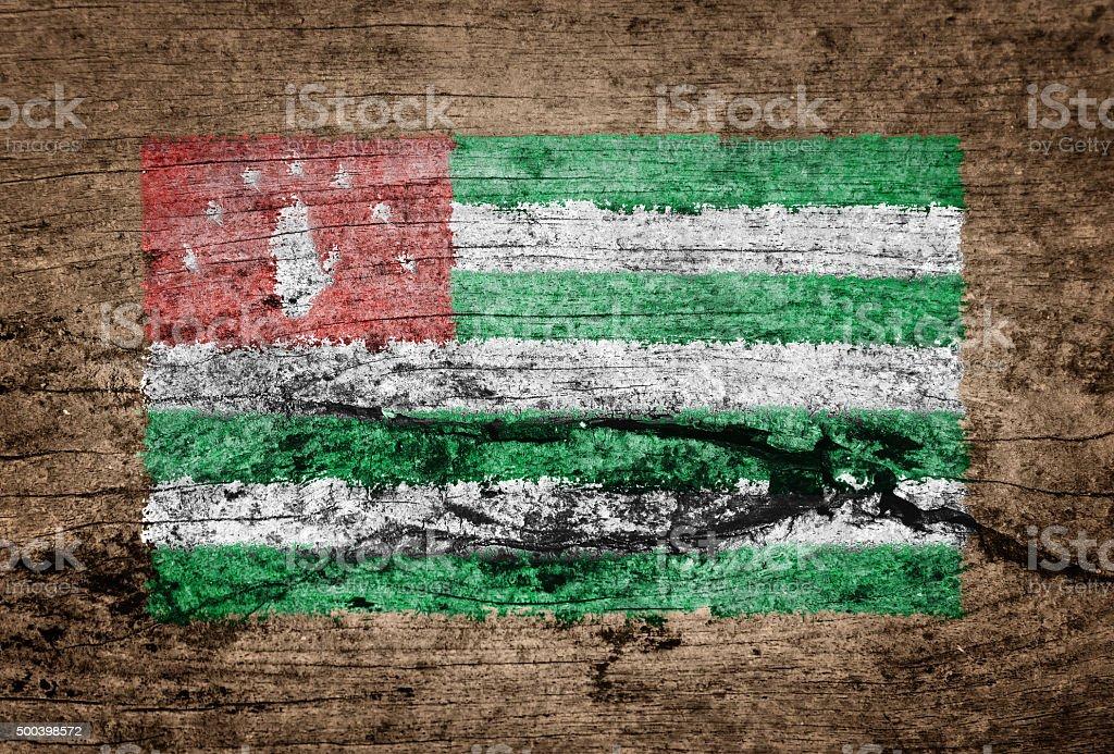 Abkhazia flag painted on wood background stock photo