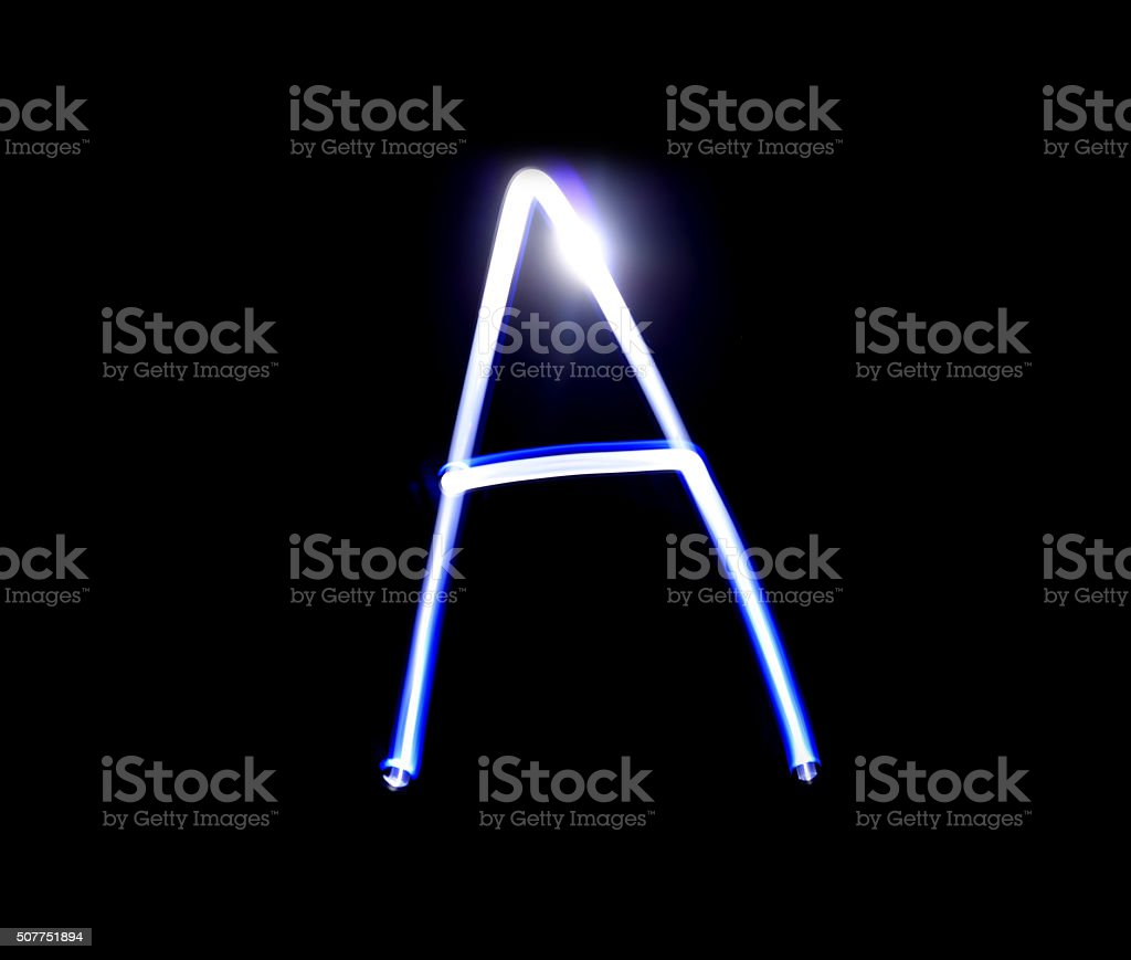 Able alphabet hand writing blue light  over black background stock photo