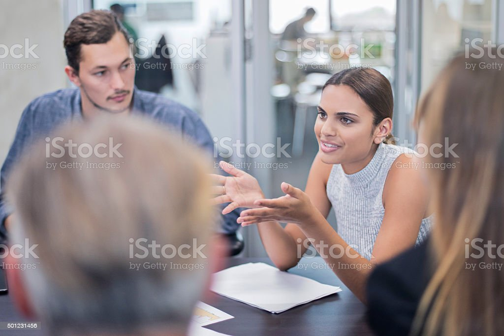 Aboriginal business woman talking in a meeting stock photo