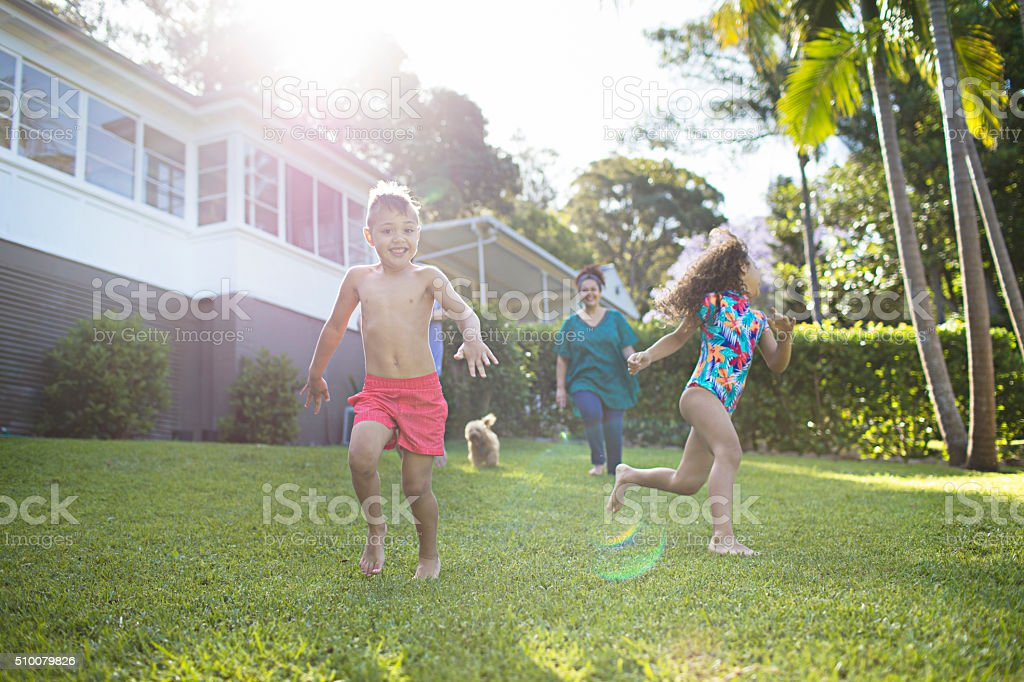 Aboriginal family enjoying the day in the garden at home stock photo