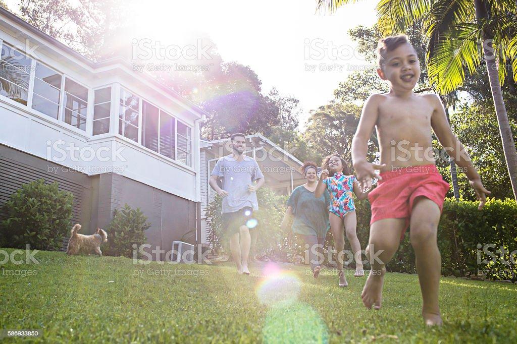 Aboriginal family having fun in the garden at home stock photo