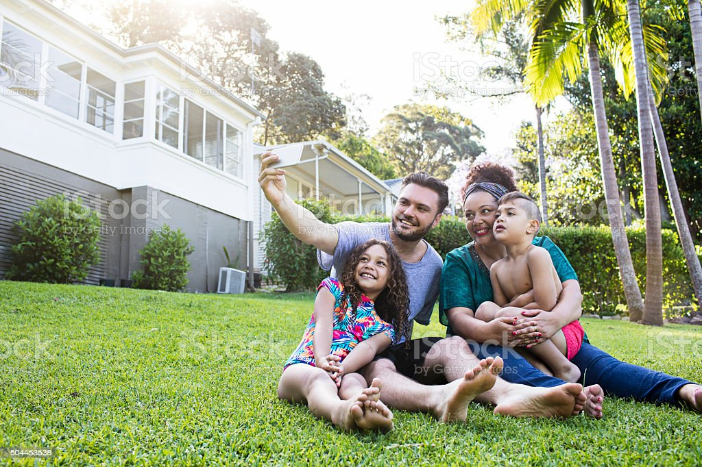Aboriginal family selfie at home stock photo