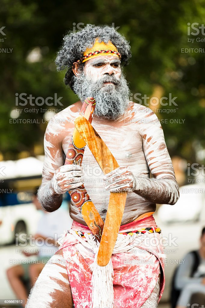 Aboriginal male dancing with boomerangs, Sydney Australia stock photo