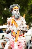 Aboriginal male dancing with boomerangs, Sydney Australia