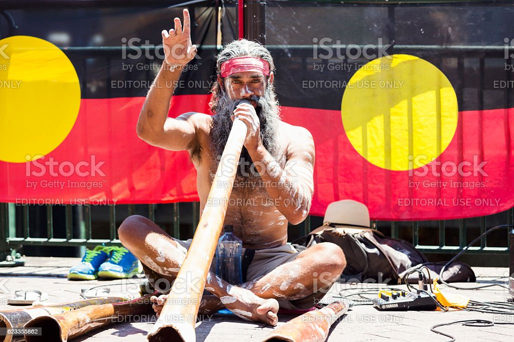 Aboriginal male playing didgeridoo, street performer, Sydney Australia stock photo