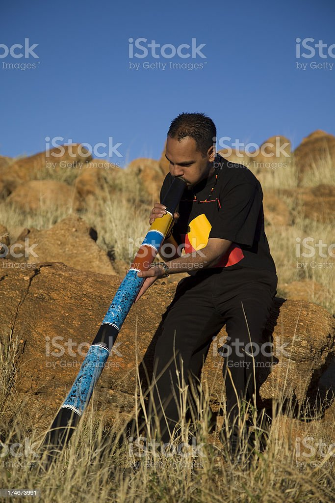 Aboriginal Man playing the Didgeridoo stock photo
