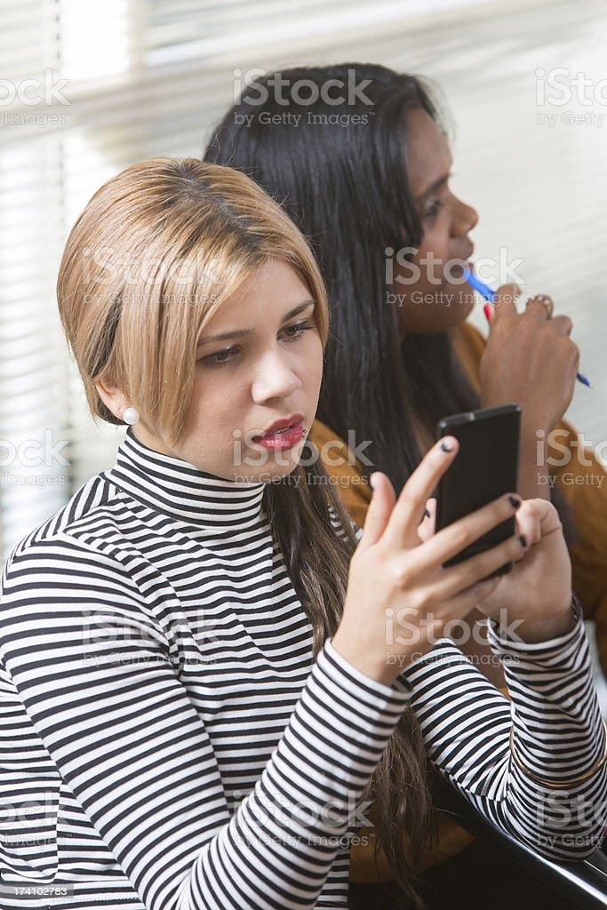 Aboriginal Woman Texting royalty-free stock photo