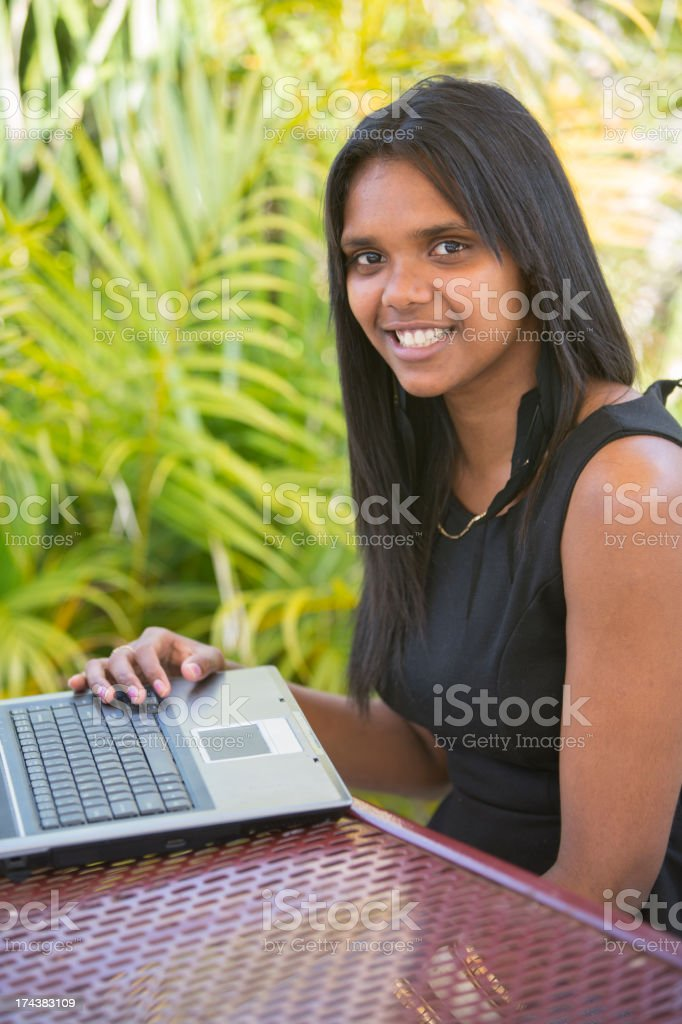 Aboriginal Woman Using a Laptop Computer royalty-free stock photo