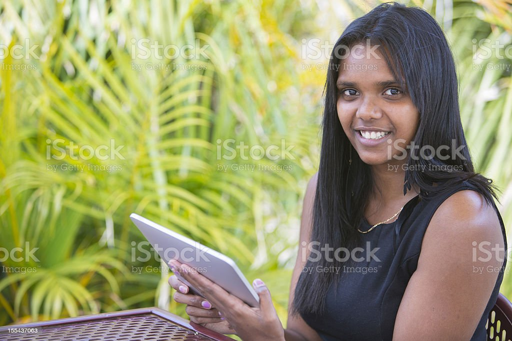 Aboriginal Woman With a Tablet Computer royalty-free stock photo