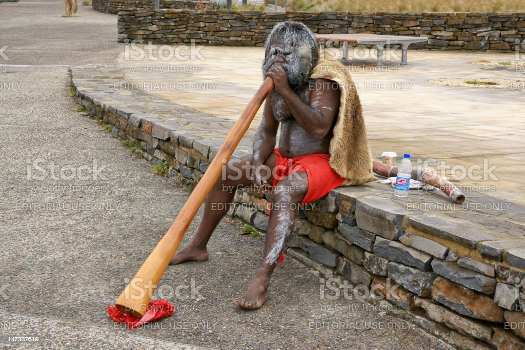 Aborigine playing on a Didgeridoo. stock photo