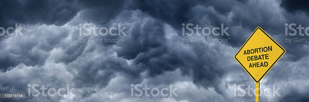 Abortion Debate Ahead Road Sign royalty-free stock photo
