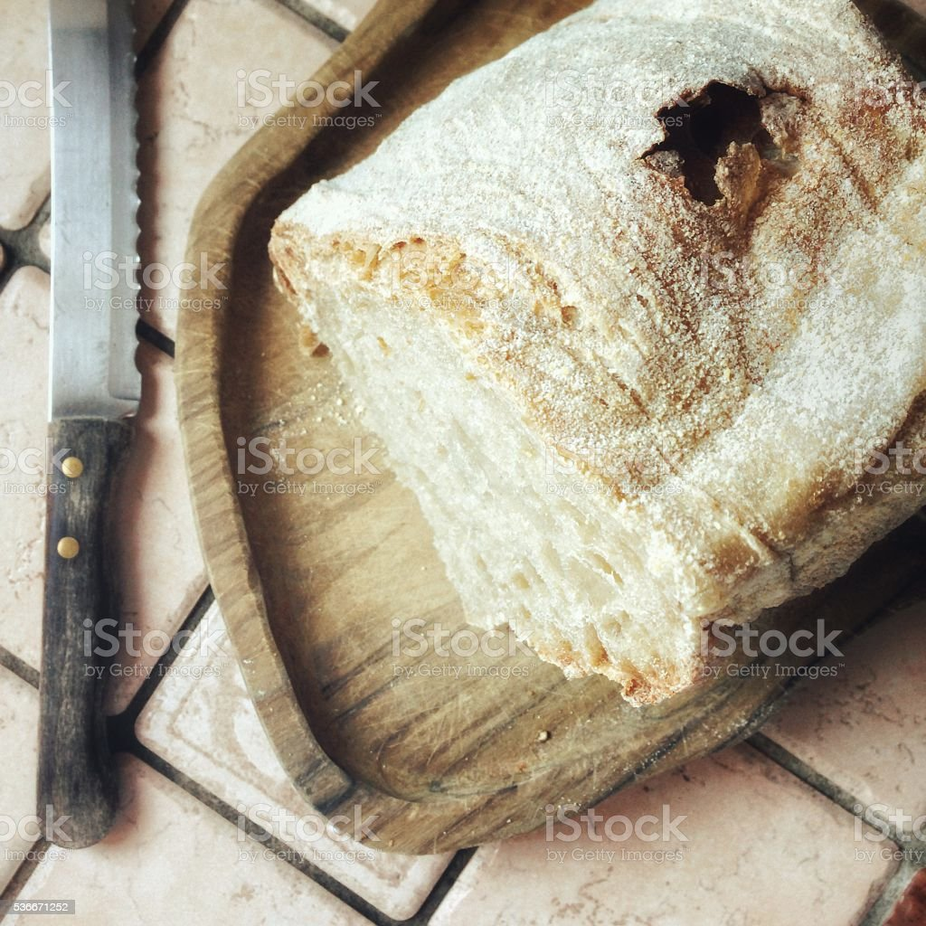 About to slice a fresh loaf of handmade bread stock photo