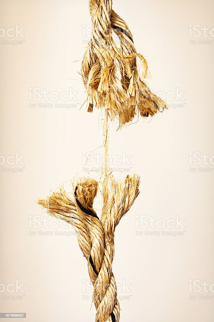 About to snap, extremely frayed rope symbolizes nervous tension royalty-free stock photo