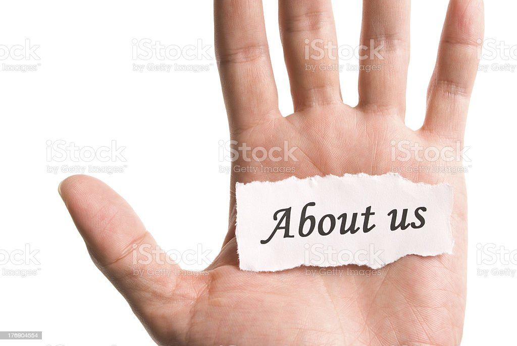 About us, word in hand royalty-free stock photo