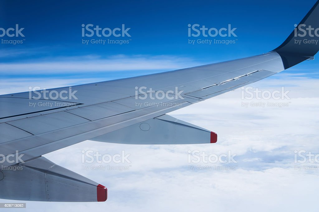 above blue sky view from aeroplane stock photo